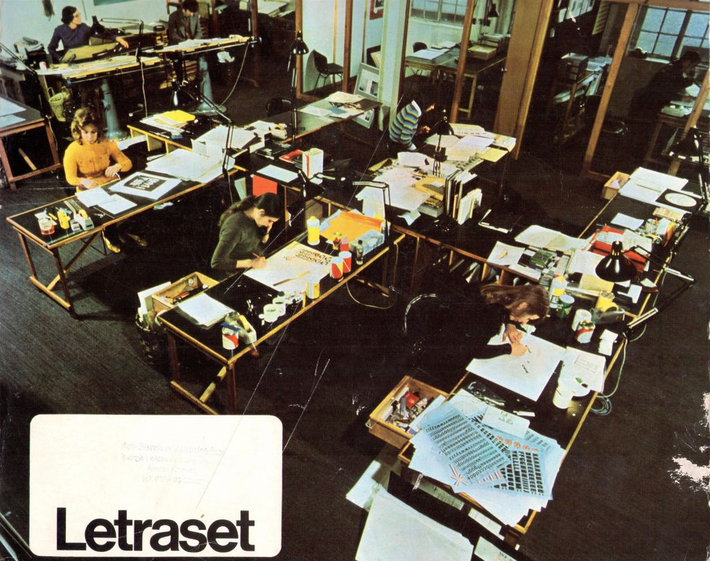 A graphic design agency or the layout department of a magazine on the cover of a Letraset catalogue, with an overview of rub-down lettering in a range of fonts and self-adhesive foils in a range of colours, patterns, symbols and signs, c.1975.