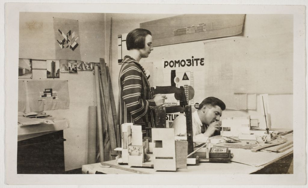 Nelly van Doesburg and Cornelis van Eesteren, working on a model, in the studio in the Rue du Moulin Vert, Paris, 1923. RKD - Nederlands Instituut voor Kunstgeschiedenis, Den Haag, Archive of Theo and Nelly van Doesburg (0408), inv.nr. 1572
